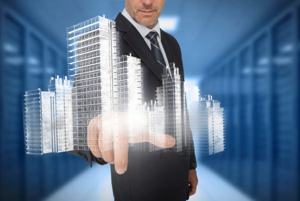 Businessman touching holographic city in blue server room