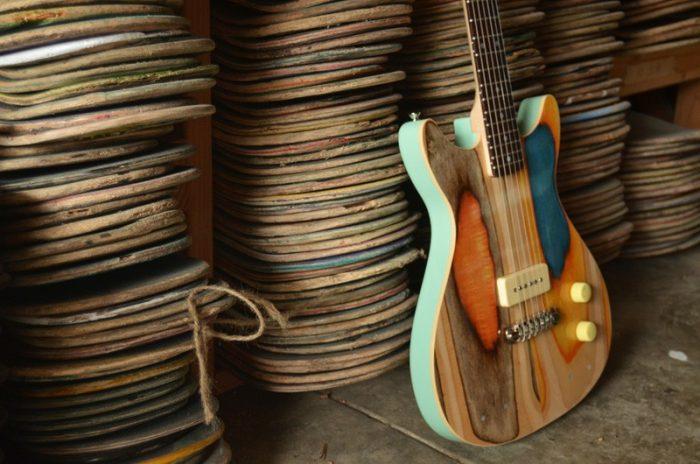 Artista faz guitarras com madeira de skates velhos